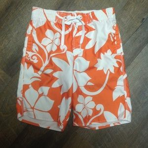 Orange Hawaiian print swim trunks